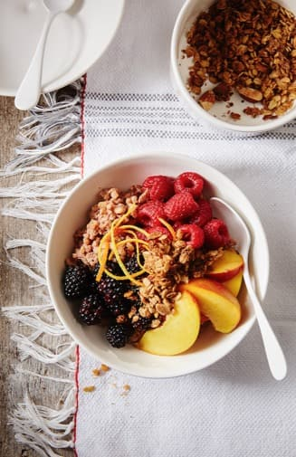 Cocoa Brown Rice Bowl with Berries and Peaches, Topped with Streusel Crunch